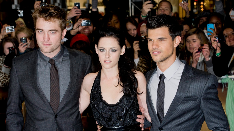 British actor Robert Pattinson, left, US actress Kristen Stewart, centre and US actor Taylor Lautner arrive for the U.K. premiere of 'Twilight Breaking Dawn Part 1' at a central London venue, Wednesday, Nov. 16, 2011. (AP / Jonathan Short)