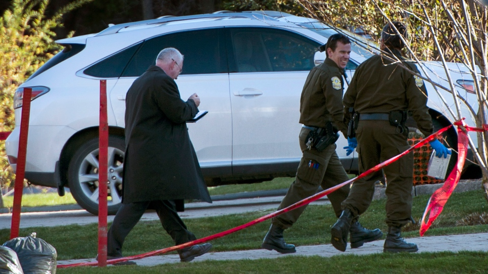 Police investigators examine the crime scene where alleged mob boss Joseph Di Maulo was murdered in front of his home Monday, Nov. 5, 2012 in Blainville, Que. north of Montreal. (Ryan Remiorz / THE CANADIAN PRESS)