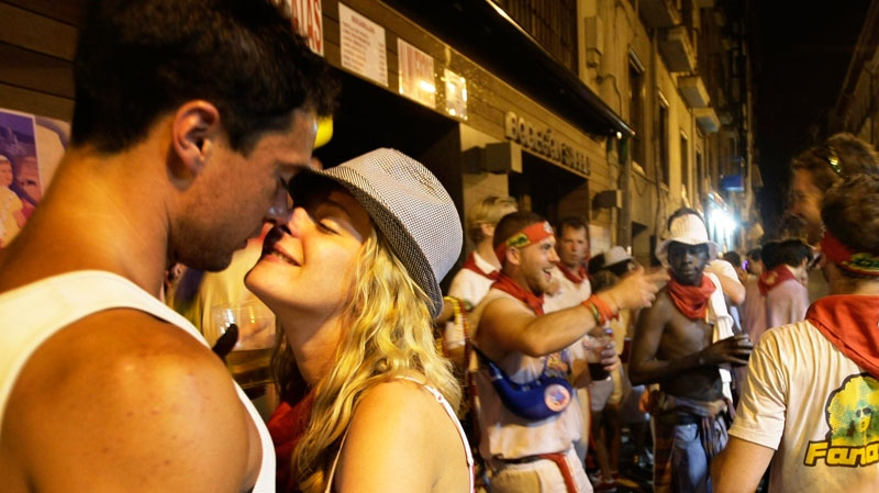 A couple kiss during the San Fermin fiestas early on Friday, July 9, 2010, in Pamplona, Spain. (AP / Ivan Aguinaga)