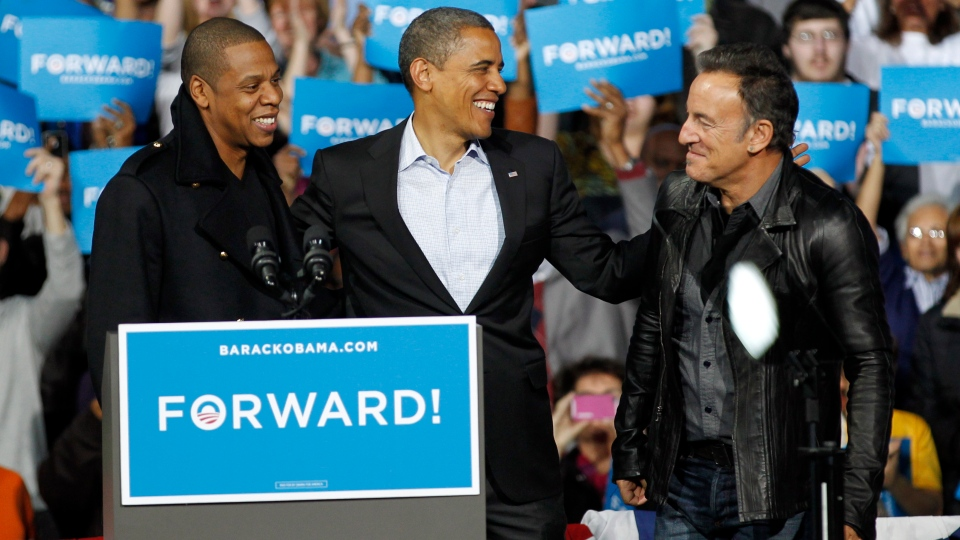 Jay-Z, left to right, U.S. President Barack Obama and Bruce Springsteen smile during a campaign event at Nationwide Arena in Columbus, Ohio on Monday, Nov. 5, 2012. (AP /Tony Dejak)