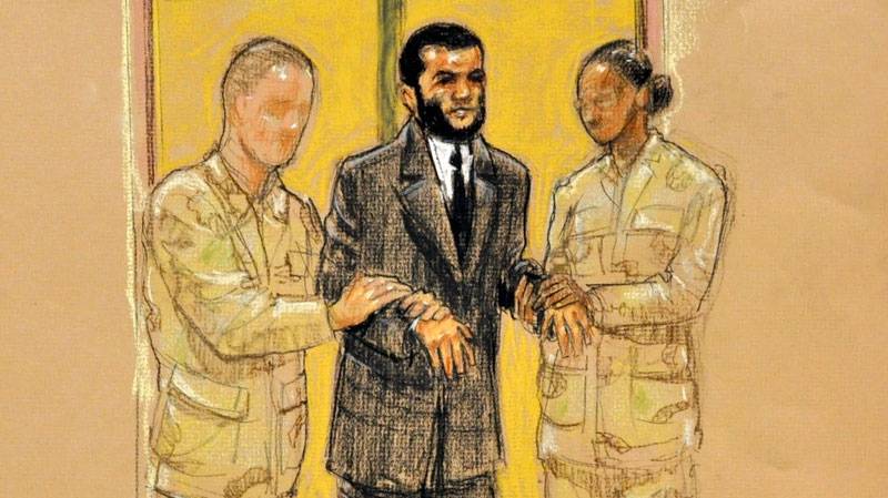 In this Pentagon-approved photograph of a sketch by artist Janet Hamlin, Omar Khadr is led into court by two Army escorts during his military tribunal in which he has pled guilty to several charges, including murder, in Guantanamo Bay, Cuba, Friday, Oct. 29, 2010. (Janet Hamlin / THE CANADIAN PRESS)