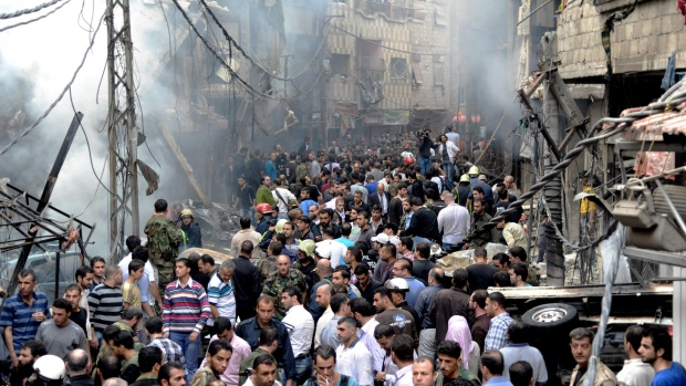 Syrians stand at centre of Damascus blast