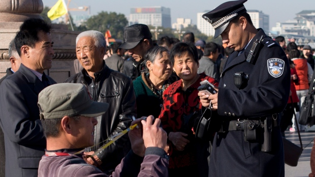 Chinese police officer in Tiananmen Square
