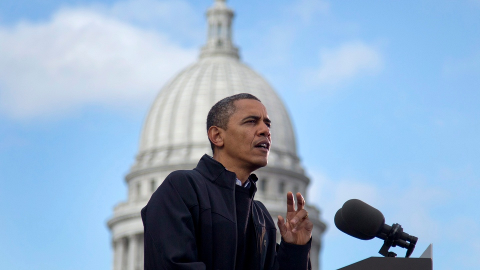 With the Wisconsin State Capitol building dome behind him, President Barack Obama speaks at a campaign event on Monday, Nov. 5, 2012, in downtown Madison, Wis. (AP Photo/Carolyn Kaster)