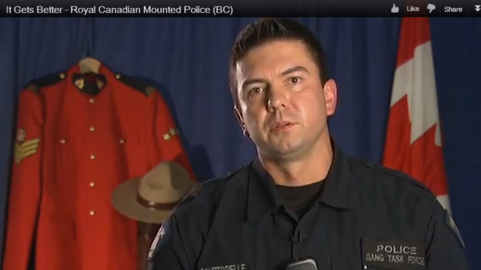 A screenshot from a YouTube video shows an RCMP officer in the 'It Gets Better' video.