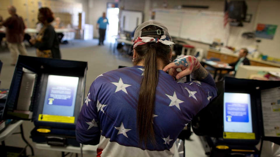 """Victor """"Snake Mann"""" Wolder, marks his choices while voting during election day on Tuesday, Nov. 6, 2012, in Las Vegas. (AP Photo/Julie Jacobson)"""