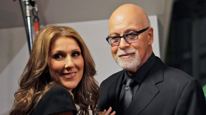 "Celine Dion, left, poses with her husband Rene Angelil, pose as they arrive for the premiere of the film ""Celine: Through the Eyes of the World"" in Miami Beach, Fla., on Feb. 16, 2010. (AP / Lynne Sladky)"
