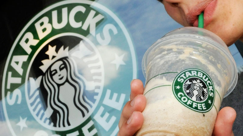 A Starbucks customer drinks a beverage outside Starbucks, in Beverly, Mass. Starbucks Corp.  (AP / Lisa Poole)