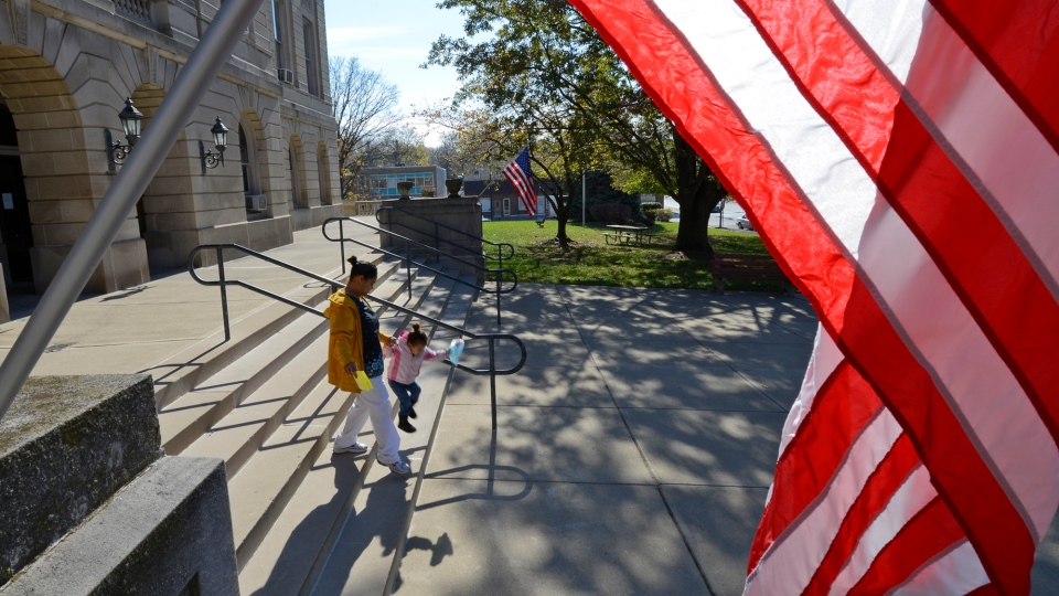 A voter leaves the Clinton County Courthouse Tuesday, Nov. 6, 2012, in Wilmington, Ohio. (AP Photo/Michael E. Keating)