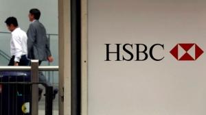 Pedestrians walk past an HSBC logo in this July 30, 2012, file photo. (AP / Vincent Yu)