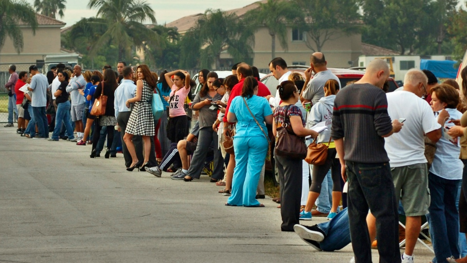 Voters wait in line to cast their ballots at a polling station, Tuesday, Nov. 6, 2012, in Miami.