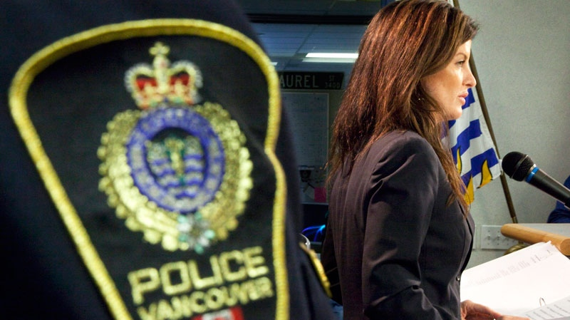 Minister for the Status of Women Rona Ambrose addresses the media during a news conference at the Vancouver Police Dept in Vancouver, Friday, Oct. 29, 2010. (Jonathan Hayward / THE CANADIAN PRESS)