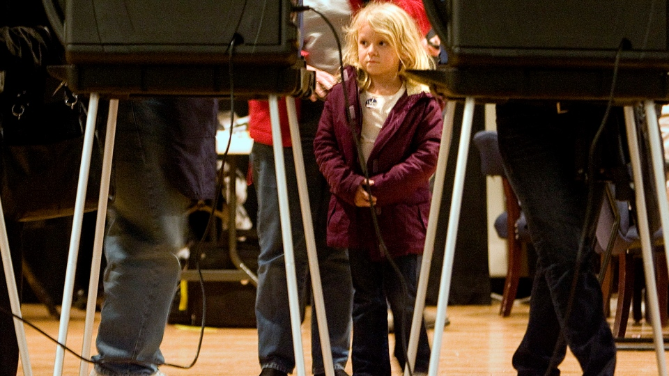 Kaiden Wallen, 6, waits as her grandmother Sharon Proulx votes at North Myrtle Beach High School in Little River, S.C., Tuesday, Nov. 6, 2012. (The Sun News / Janet Blackmon Morgan)