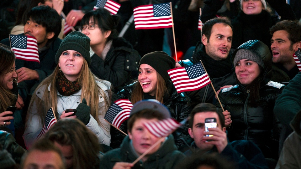 Supporters of U.S. President Barack Obama reacts to positive predictions for her candidate as crowds watch election results in Times Square in New York, Tuesday, Nov. 6, 2012. (AP / John Minchillo)