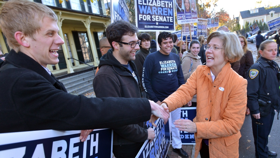 Democrat candidate for U.S. Senate Elizabeth Warren, center right, greets supporters outside the polls after voting in Cambridge, Mass. on Election Day, Tuesday, Nov. 6, 2012. (AP / Josh Reynolds)