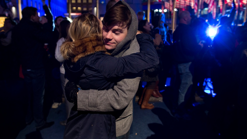 Ryan Charchian, 18, of New York, hugs Allie Rapa, 19, of New York after news reports projected U.S. President Barack Obama to win a second term as they celebrated in New York, on Tuesday, Nov. 6, 2012. (AP /Craig Ruttle)