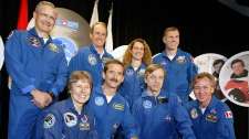 Astronauts Roberta Bondar,first row, left to right, Chris Hadfield, Robert Thirsk, Bjarni Tryggvason Marc Garneau, second row, left to right, Steve Maclean, Julie Payette and Dave Williams pose for a photo at the John H. Chapman Space Centre in St. Hubert, Quebec on Friday Sept. 26, 2003. (Andre Pichette / THE CANADIAN PRESS)