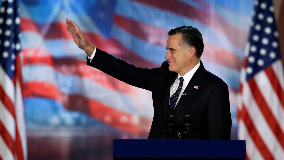 U.S. Republican presidential candidate and former Massachusetts Gov. Mitt Romney waves to supporters during his election night rally, in Boston on Wednesday, Nov. 7, 2012. (AP / Elise Amendola)