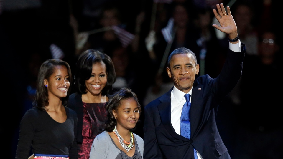 U.S. President Barack Obama waves as he walks on stage with first lady Michelle Obama and daughters Malia and Sasha at his election night party Wednesday, Nov. 7, 2012, in Chicago.(AP / Chris Carlson)