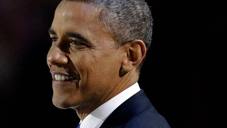 U.S. President Barack Obama smiles during his speech at his election night party in Chicago on Wednesday, Nov. 7, 2012. (AP / M. Spencer Green)