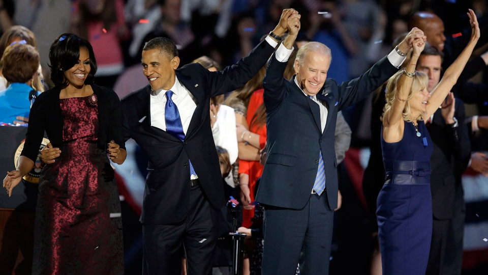 U.S. President Barack Obama, first lady Michelle Obama, Vice President Joe Biden and Jill Biden wave at his election night party  in Chicago, Wednesday, Nov. 7, 2012. (AP / Chris Carlson)