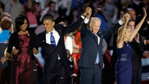 U.S. President Barack Obama, first lady Michelle Obama, Vice President Joe Biden and Jill Biden wave at his election night party in Chicago on Wednesday, Nov. 7, 2012. (AP / Chris Carlson)