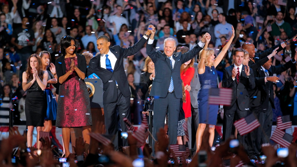 U.S. President Barack Obama and wife Michelle is holds hands with Vice President Joe Biden and his wife Jill following Obama's victory speech to supporters in Chicago early Wednesday, Nov. 7 2012. (AP / Jerome Delay)