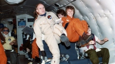 Canadian astronauts Ken Money and Roberta Bondar get a feel for zero-gravity during trining on board NASA's KC135 aircraft on Dec. 18, 1984. (UPC / THE CANADIAN PRESS)