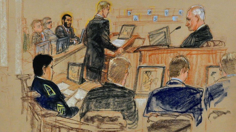 In this Pentagon-approved photograph of a sketch by artist Janet Hamlin, Prosecutor Jeffrey Groharing addresses the military panel, seen as blue numbered cards, in closing arguments in Guantanamo Bay, Cuba, Saturday, Oct. 30, 2010. (Janet Hamlin / THE CANADIAN PRESS)