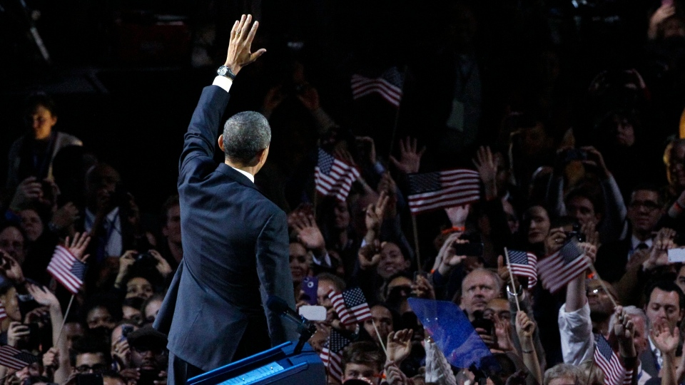 U.S. President Barack Obama waves at his election night party in Chicago. Obama efeated Republican challenger former Massachusetts Gov. Mitt Romney. (AP Photo/Nam Y. Huh)