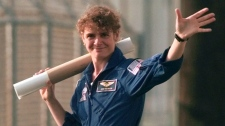 Canadian Astronaut Julie Payette waves at the Kennedy Space Center, Fla., shuttle landing strip after flying a T-38 training aircraft Tuesday, May, 25, 1999, in preparation for the liftoff of the space shuttle Discovery May 27. (AP / Wilfredo Lee)