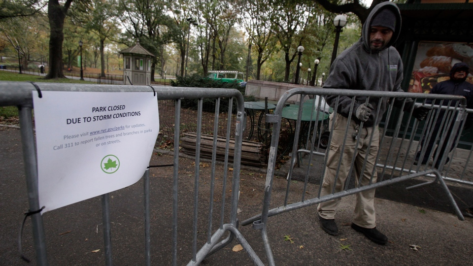 Sam Vargas, of the Central Park Conservancy, prepares barriers to close New York's Central Park, Wednesday, Nov. 7, 2012.  (AP / Richard Drew)