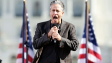 Comedian Jon Stewart shouts to the crowd during the Rally to Restore Sanity and/or Fear with comedian Stephen Colbert on the National Mall in Washington, Saturday, Oct. 30, 2010. (AP / Carolyn Kaster)