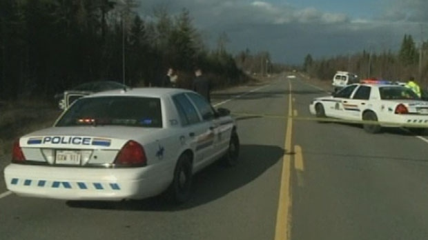 Police investigate the discovery of a woman's body on Killarney Road, north of Fredericton, on Tuesday, Nov. 6, 2012.