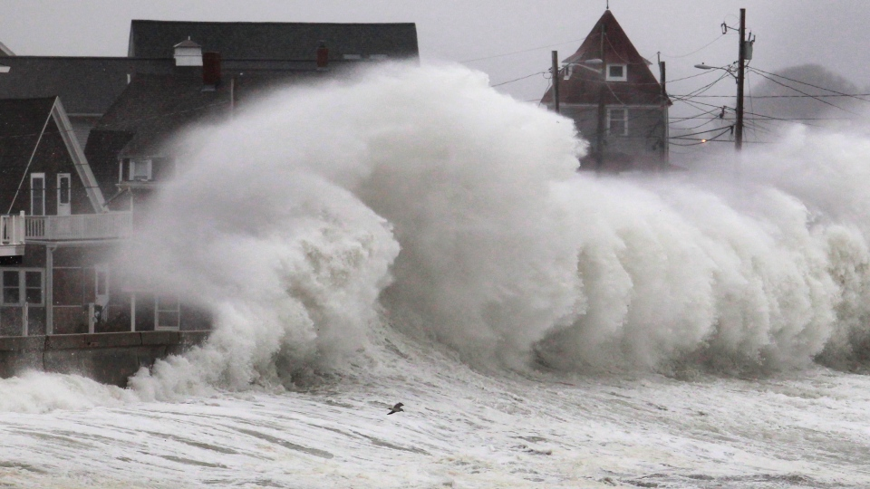 Waves crash into a seawall and buildings along the coast in Hull, Mass., Wednesday, Nov. 7, 2012.  (AP / Steven Senne)