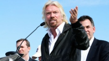 British billionaire and Virgin Galactic founder Sir Richard Branson talks about his vision for commercial space travel during a dedication ceremony for the runway at Spaceport America in Upham, N.M., on Friday, Oct. 22, 2010. (AP / Susan Montoya Bryan)