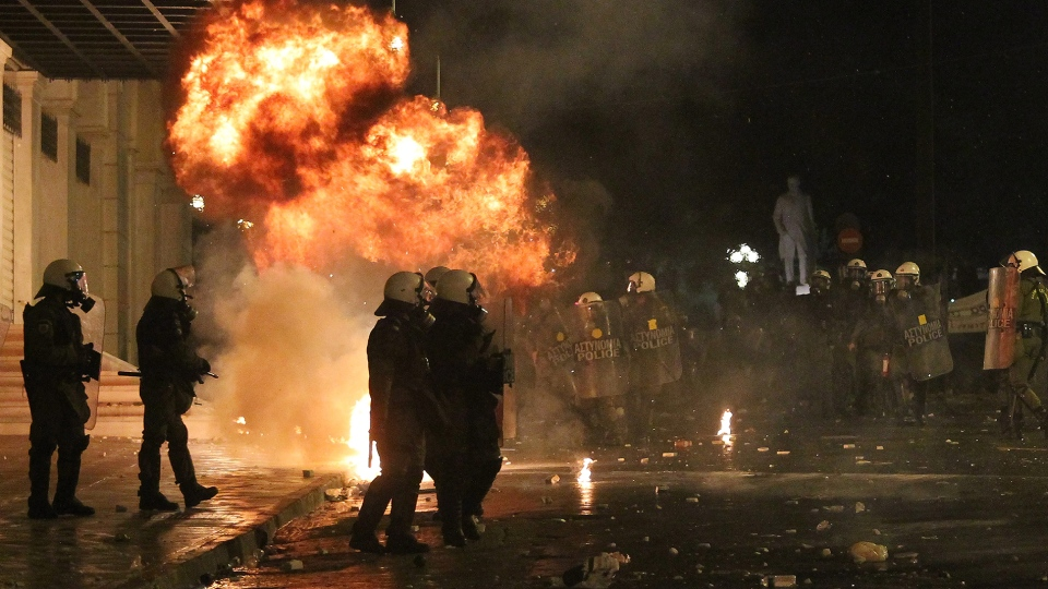 A petrol bomb thrown by protesters explodes near riot police in front of the parliament during clashes in Athens on Wednesday Nov. 7, 2012. (AP / Nikolas Giakoumidis)