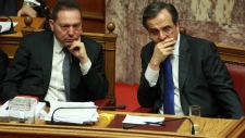 Greece narrowly passes austerity measures