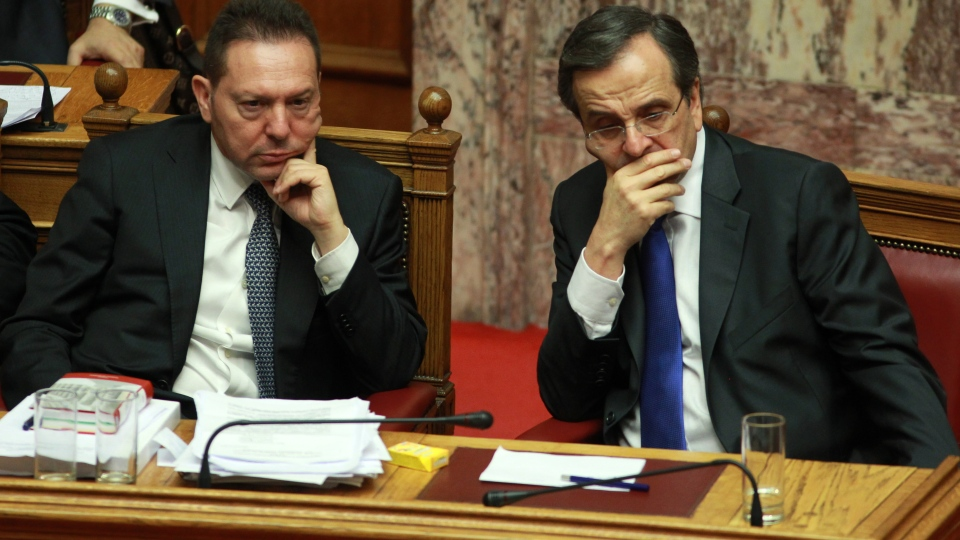 Greece's Prime Minister Antonis Samaras, right, and Finance Minister Yannis Stournaras attend a vote for the new austerity measures at the Greek parliament in Athens, Wednesday, Nov. 7, 2012. (AP / Thanassis Stavrakis)