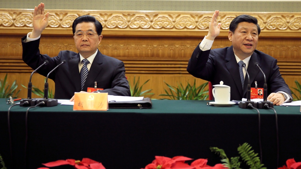 Hu Jintao, left, and Xi Jinping attend the first meeting of the presidium of the 18th National Congress of the Communist Party of China (CPC) at the Great Hall of the People in Beijing, China, Wednesday, Nov. 7, 2012. (AP / Xinhua, Lan Hongguang)