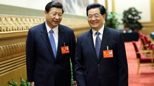 In this Wednesday, Nov. 7, 2012 photo released by China's Xinhua News Agency, Hu Jintao, right, and Xi Jinping walk together after the first meeting of the presidium of the 18th National Congress of the Communist Party of China (CPC) in Beijing, China. (AP / Xinhua, Lan Hongguang)
