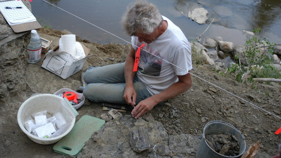 Philip Currie, a paleontologist with the University of Alberta, at a dig site in the Grande Prairie, Alta. area in 2003. (Courtesy of Royal Tyrrell Museum)