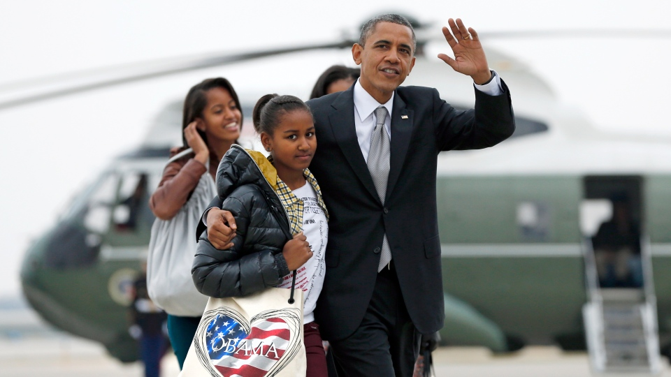 U.S. President Barack Obama walks with daughter Sasha as first lady Michelle Obama walks with Malia, from Marine One to board Air Force One at Chicago O'Hare International Airport on Wednesday, Nov. 7, 2012. (AP /Carolyn Kaster)