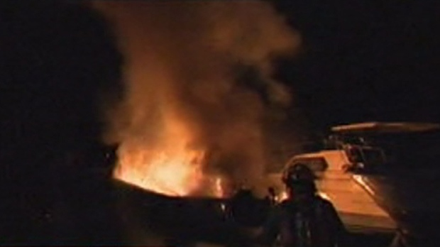 Firefighters battle a boat fire at the Toronto Humber Yacht Club early Thursday, Nov. 8, 2012.