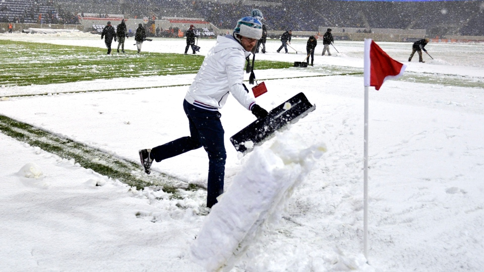 Workers attempt to clear the snow from the field before the New York Red Bulls' MLS Eastern Conference semifinal playoff soccer match against DC United was postponed, Wednesday, Nov. 7, 2012, in Harrison, N.J. (AP / Bill Kostroun)