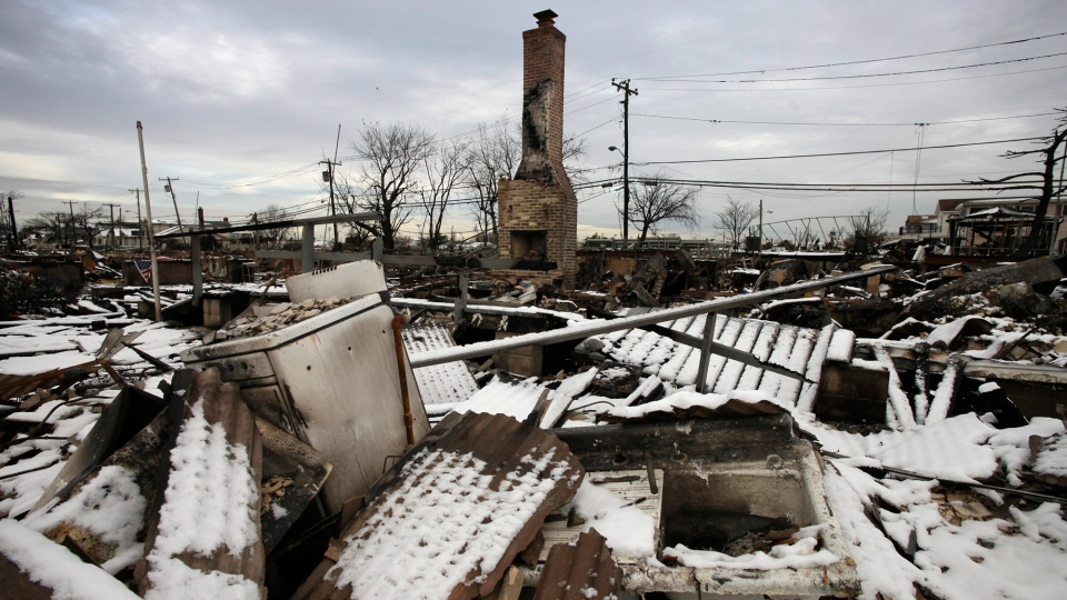 A fire-scorched landscape of Breezy Point is shown after a nor'easter snow, Thursday, Nov. 8, 2012 in New York. (AP / Mark Lennihan)