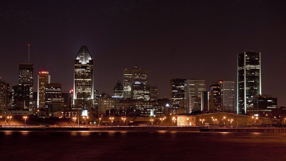 The Montreal evening skyline is shown in this March 28, 2009 file photo. (Peter McCabe / The Canadian Press)