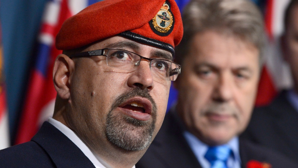 Veteran Dave Desjardins speaks as NDP critic Peter Stoffer looks on during a news conference in Ottawa, Thursday, Nov. 8, 2012. (Adrian Wyld / The Canadian Press)