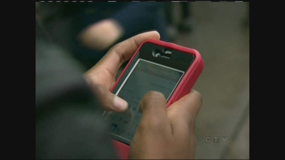 Teen texts on a cell phone