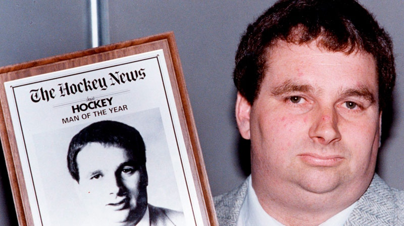 Graham James holds his award after being named The Hockey News man of the year in Toronto, June 8, 1989. (Bill Becker / THE CANADIAN PRESS)